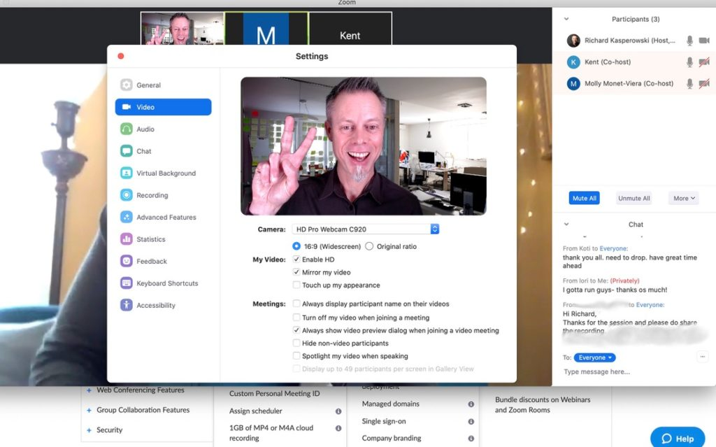 Man smiling and waving in on online video conference window